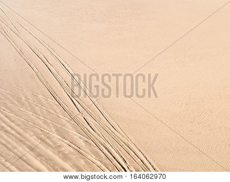 Tyre tracks on the sand dunes on the Namib Desert Namibia.