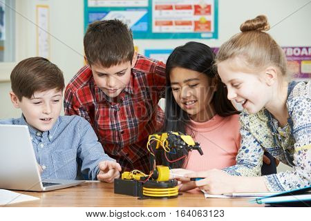 Group Of Pupils In Science Lesson Studying Robotics