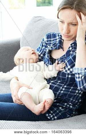 Frustrated Mother Suffering From Post Natal Depression