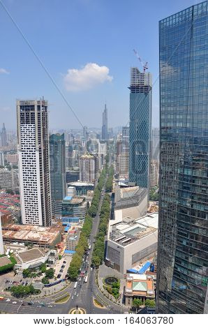 NANJING, CHINA - AUG. 6, 2012: Aerial view of Nanjing City center skyline (North) with unfinished Jinling Hotel on the left, Deji Plaza on the right, viewed from Xinjiekou CBD, Nanjing, Jiangsu, China
