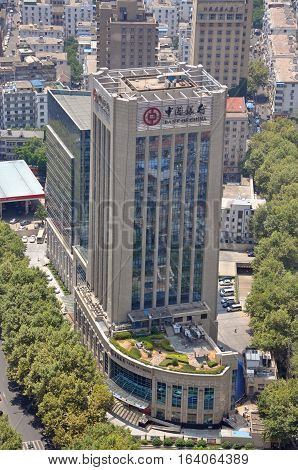 NANJING, CHINA - AUG. 6, 2012: Aerial view of Bank of China Jiangsu Branch in Xinjiekou CBD, Nanjing, Jiangsu Province, China.