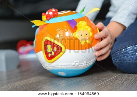Child hands on learning toy suggesting early education