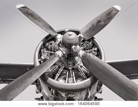 engine of an old aircraft against the sky