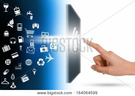 Modern communication technology with human finger touching a screen