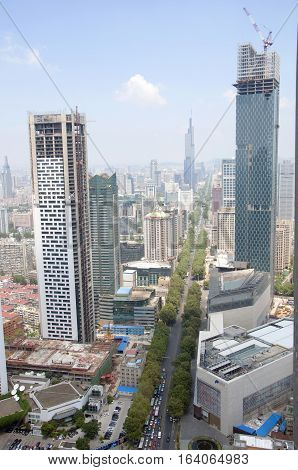 NANJING, CHINA - AUG. 6, 2012: Aerial view of Nanjing City center skyline (North) with unfinished Jinling Hotel on the left, Deji Plaza on the right and Zifeng Tower far away, Nanjing, Jiangsu, China.