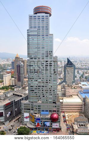 NANJING, CHINA - AUG. 6, 2012: Shangmao Hotel, viewed from Xinjiekou CBD, Nanjing, Jiangsu Province, China.