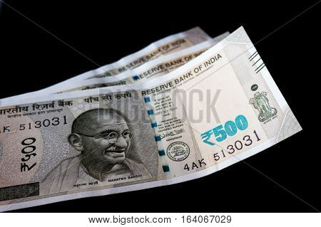 New Indian currency note for Rs.500 post the demonitization. Isolated on black