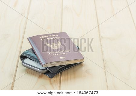 Passport, Wallet And Mobile Phone For Travel Concept