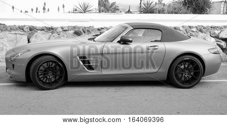 Marbella, Andalusia, Spain - Januari 3, 2017: Mercedes Benz SLS AMG Roadster parked on a public parking spot in the city of Marbella. Nobody in the vehicle.