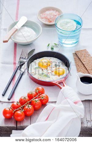 Fried Eggs in a red pan for breakfast