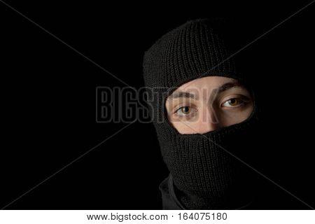 Caucasian man wearing a balaclava mask hiding his face