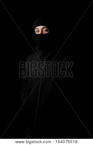 Caucasian man wearing a balaclava masking his face