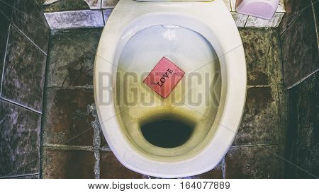 Dirty Public Toilet On Tile Tile, Words On Paper Sticker