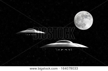 3d render of flying saucers over stars background and moon
