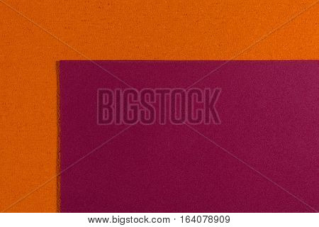 Eva foam ethylene vinyl acetate smooth red surface on orange sponge plush background