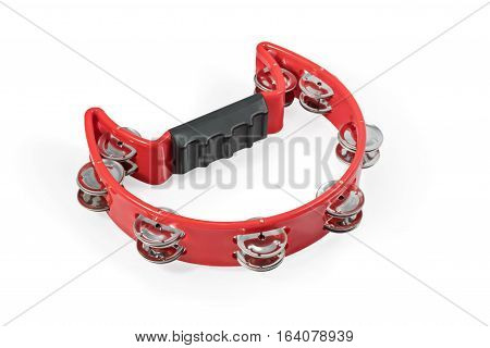 Red curved plastic tambourine with metal plates isolated on white background