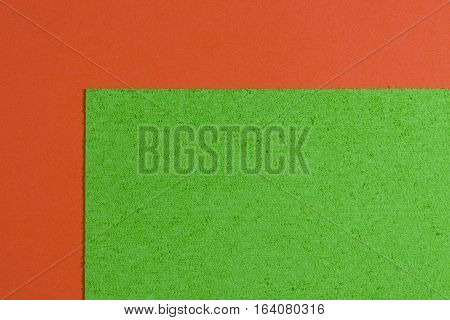 Eva foam ethylene vinyl acetate sponge plush apple green surface on orange smooth background