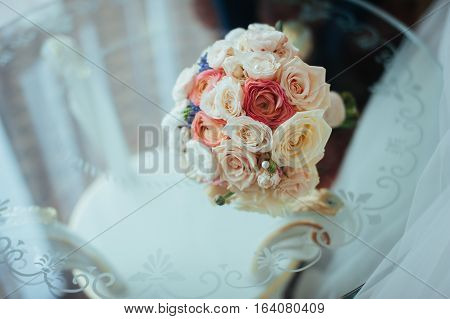 beautiful bridal bouquet lying on the table