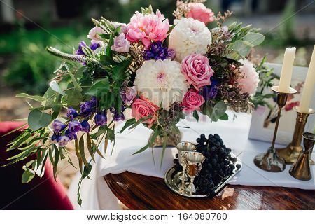 A beautiful bridal bouquet of different flowers. Decoration