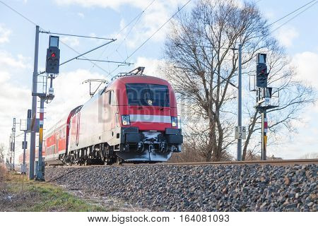 german passenger train drives to the next station