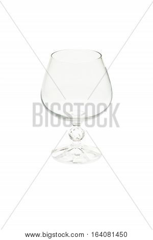 Isolated empty cognac glass, brandy snifter on white background