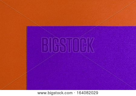 Eva foam ethylene vinyl acetate sponge plush purple surface on orange smooth background