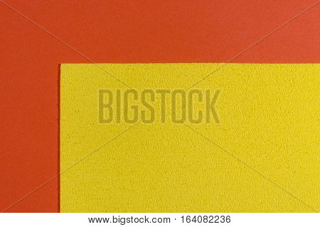 Eva foam ethylene vinyl acetate sponge lemon yellow surface on orange smooth background