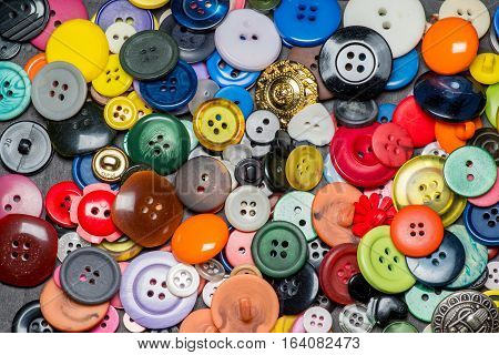Collection of colorful sewing  plastic buttons background
