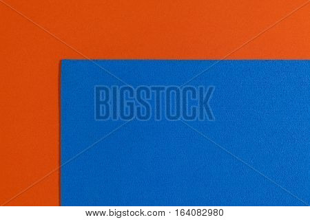 Eva foam ethylene vinyl acetate sponge blue surface on orange smooth background
