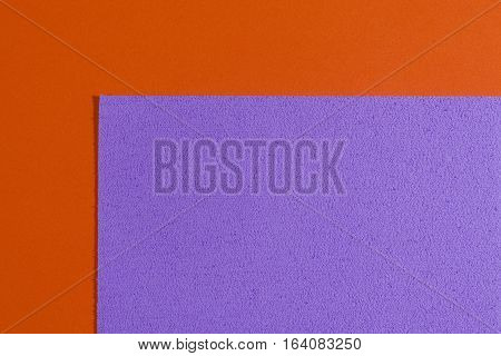 Eva foam ethylene vinyl acetate sponge violet surface on orange smooth background