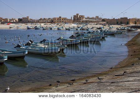 MIRBAT, OMAN - JANUARY 07,2016: small fishing boats in Mirbat, Dhofar, Oman