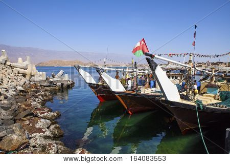 MIRBAT, OMAN - JANUARY 07,2016: Fishing boats (Dhow) in Mirbat port. Dhofar, Oman.