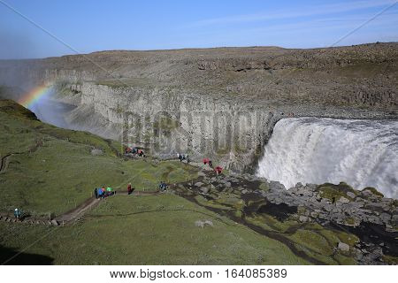 Dettifoss, Iceland - August 13, 2015: Tourist at Dettifoss waterfall Iceland. Dettifoss is located in  Vatnajjokull National Park in Northeast Iceland and a popular place for Tourists
