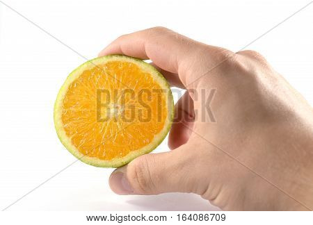 Male Hand Holding Half Of A Cut Orange Fruit