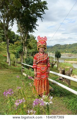 CHIANG RAITHAILAND - JANUARY 3 : Unidentified Mong tribe young woman with traditional clothes and silver jewelery in hill tribe minority village on January 3 2017. Chiang Rai Thailand.