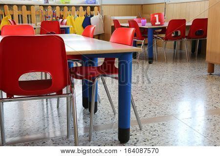 Red Chairs With Small Benches Inside A Kindergarten For Children