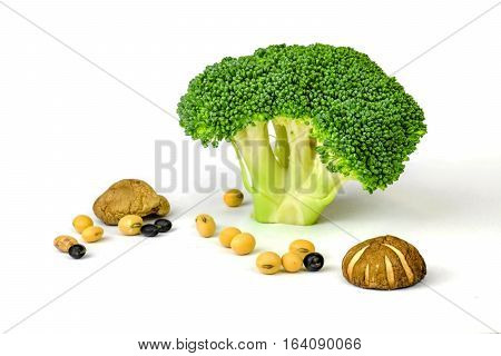 Fresh green Broccoli on white background close-up