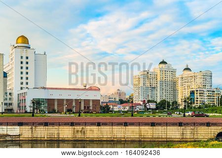 BELGOROD RUSSIA - JULY 04 2016: City embankment of the river Vezelka. The campus of the Belgorod State University. Detail of the main building of university with observatory and residential complex