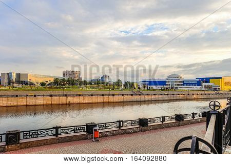 BELGOROD RUSSIA - JULY 04 2016: Belgorod cityscape. View from the embankment of river Vezelka at training facility Svetlana Khorkina (building in Belgorod State University complex) and avenue of Bohdan Khmelnytsky.