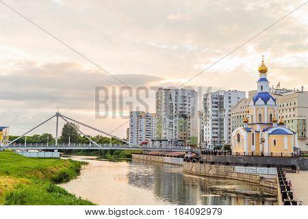 BELGOROD RUSSIA - JULY 04 2016: Belgorod cityscape. Embankment river Vezelka with a view of the temple Archangel Gabriel.