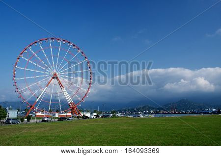 Ferris wheel on Batumi seafront with Caucasus mountains on the background ,Black Sea,Georgia,Adzharia