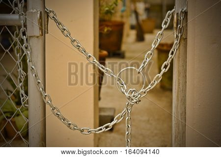 Locked fence, protection home, metal chain lock,