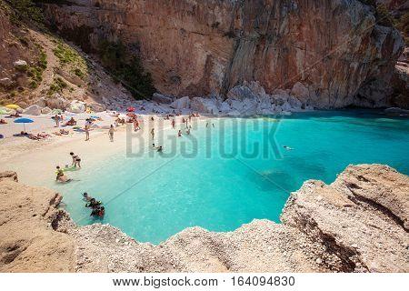 SARDEGNA ITALY - 24 June 2016: People on the beatiful beach Cala Mariolu bay BAUNEI SARDEGNA