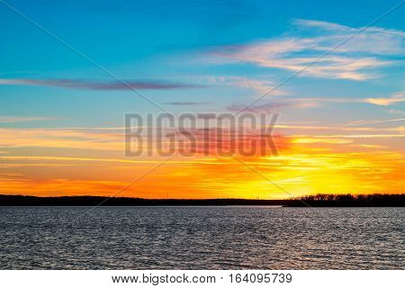 Colorful sunset over a lake in Oklahoma.