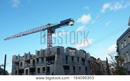 Construction of a modern building with crane