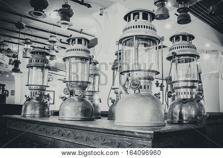 Group Of Old Vintage Storm Lanterns, Hurricane Lamp Put On Vintage Cabinet Wood. Vintage Lamp Concep