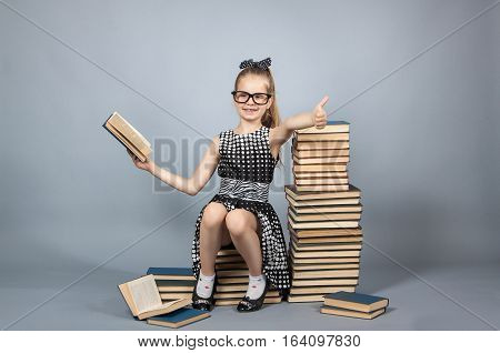 Girl With Glasses Reading A Book