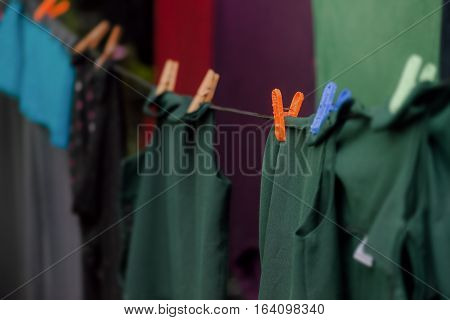 Washing line with clean dark clothes drying eco-friendly outdoors hanging