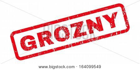 Grozny text rubber seal stamp watermark. Tag inside rounded rectangular shape with grunge design and scratched texture. Slanted glyph red ink sticker on a white background.