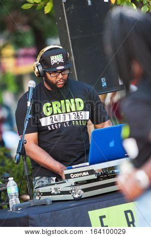 ATLANTA, GA - OCTOBER 2016:  A deejay uses sophisticated electronics to enhance the audio and play rap music at the Atlanta Hip Hop Day a free event open to the public in Woodruff Park in Atlanta GA on October 8 2016.